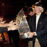 Bill Neukom holds the World Series trophy while showing it to fans who gathered early in the morning to welcome the Giants home outside AT&T Park in San Francisco, Calif., on Tuesday, November 2, 2010.