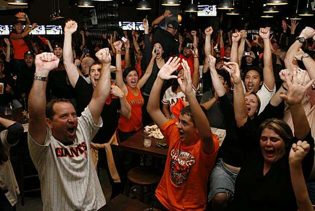 San Francisco Giants fans celebrate at Public House in AT&T Park in San Francisco, Calif., after watching the San Francisco Giants win the 2010 World Series in Texas on Monday, Nov, 1, 2010. Photo: Kirsten Aguilar, The Chronicle