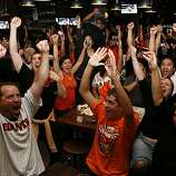 San Francisco Giants fans celebrate at Public House in AT&T Park in San Francisco, Calif., after watching the San Francisco Giants win the 2010 World Series in Texas on Monday, Nov, 1, 2010.