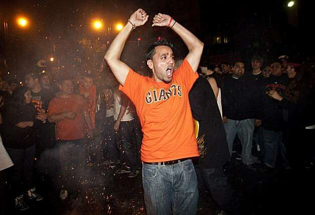 A Giants fan cheers around a bonfire in celebration of the World Series win just after midnight in San Francisco, Calif., on Tuesday, November 2, 2010. Photo: Laura Morton, Special To The Chronicle