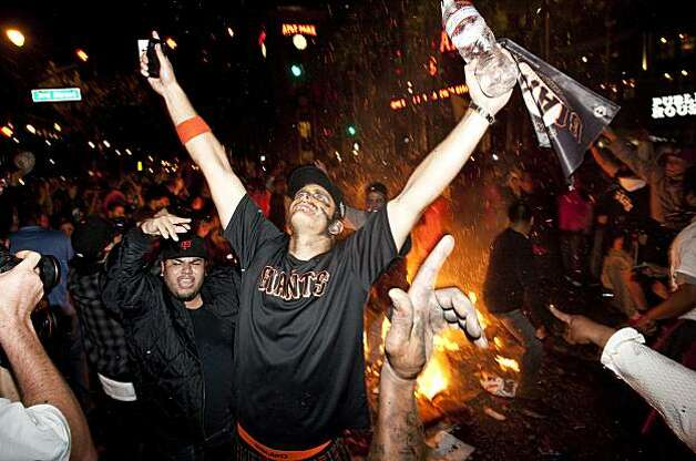 Giants fans celebrate the World Series win around a bonfire in the street at the intersection of 3rd Street and King Street in San Francisco, Calif., on Monday, November 1, 2010. Photo: Laura Morton, Special To The Chronicle