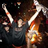 Giants fans celebrate the World Series win around a bonfire in the street at the intersection of 3rd Street and King Street in San Francisco, Calif., on Monday, November 1, 2010.