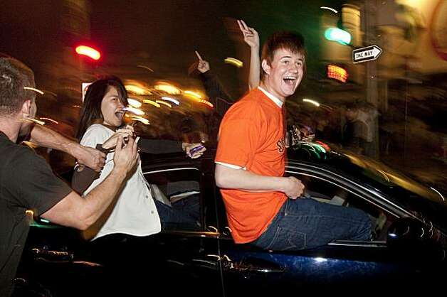 Giants fans celebrate the World Series win in the streets outside AT&T Park in San Francisco, Calif., on Monday, November 1, 2010.  The Giants beat the Texas Rangers 3-1 in Game 5 of the World Series. Photo: Laura Morton, Special To The Chronicle