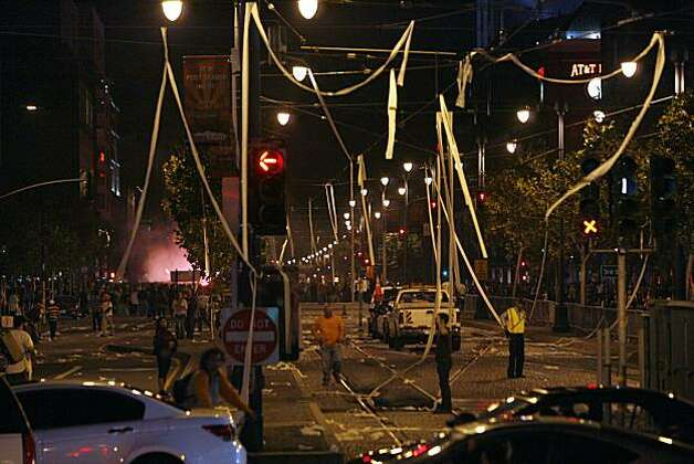 Electric lines hanging over Townsend and 4th Streets in San Francisco, Calif. are toilet papered as fans celebrate the San Francisco Giants win at the 2010 World Series in Texas on Monday, Nov, 1, 2010. Photo: Kirsten Aguilar, The Chronicle