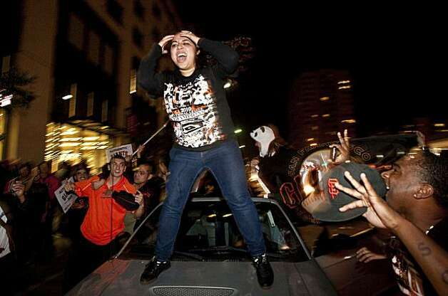 Ariana Rodriguez dances on a car in celebration of the World Series win in San Francisco, Calif., on Monday, November 1, 2010.  The Giants beat the Texas Rangers 3-1 in Game 5 of the World Series. Photo: Laura Morton, Special To The Chronicle