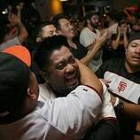Reggie Palacioz celebrates at Public House at AT&T Park after watching the San Francisco Giants win the 2010 World Series in Texas on Monday, Nov, 1, 2010.