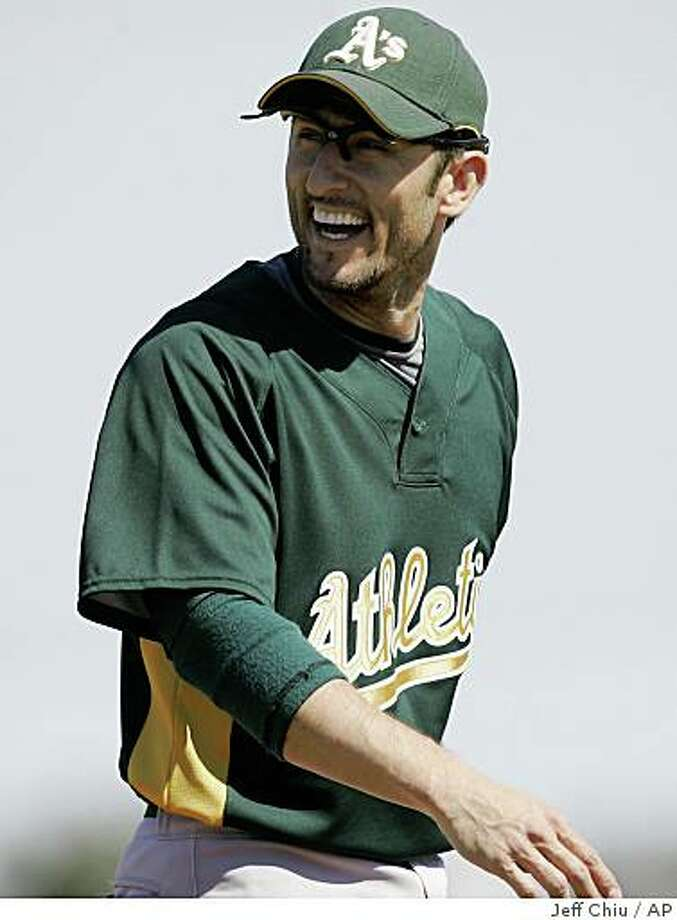 Oakland Athletics' Nomar Garciaparra laughs while playing third base against the Los Angeles Angels in the third inning of their spring training baseball game in Tempe, Ariz., Sunday, March 15, 2009. Garciaparra made his spring debut with the Athletics at third base. (AP Photo/Jeff Chiu) Photo: Jeff Chiu, AP