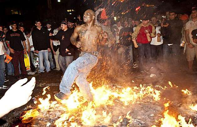 A Giants fan celebrates the World Series win by running through a bonfire in the street at the intersection of 3rd Street and King Street in San Francisco, Calif., on Monday, November 1, 2010. Photo: Laura Morton, Special To The Chronicle