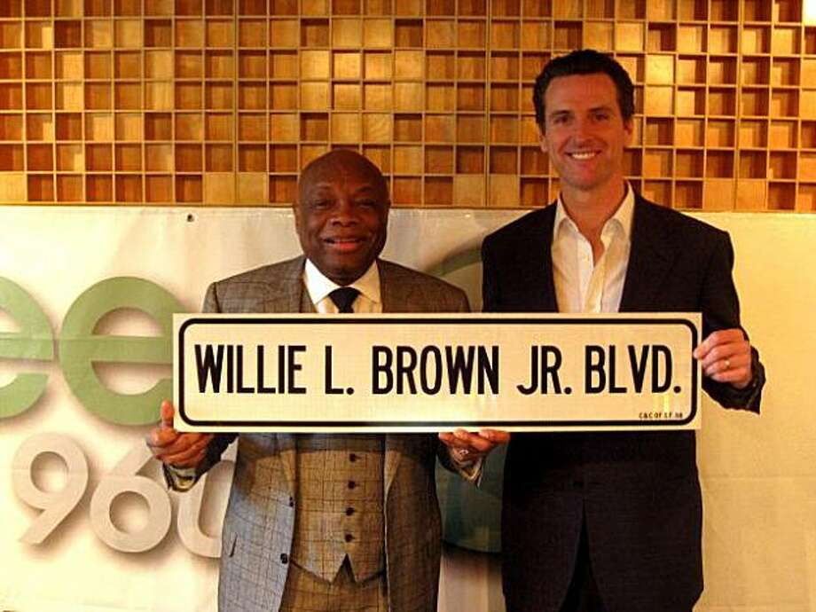 Former San Francisco mayor Willie Brown poses with Gavin Newsom, after the taping of Newsom's weekly radio address, with a street sign on March 13, 2009 in San Francisco, Calif. Newsom revealed to Brown, who was his guest on the show, the idea of renaming Third Street in his honor. Photo: Meagan Phillips, Office Of The Mayor