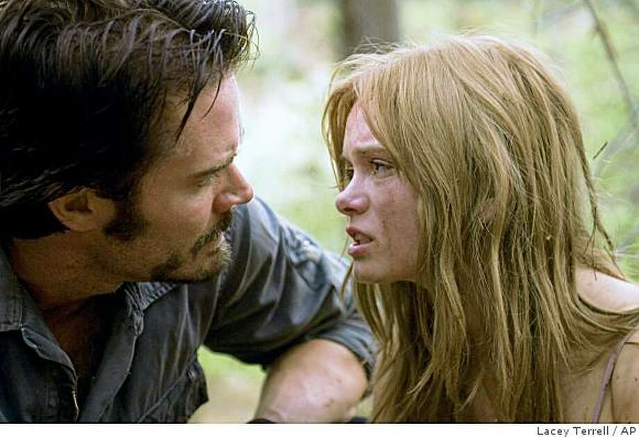 "In this film still released by Rogue Pictures, Garret Hillahunt, left, and Sara Paxton are shown in a scene from, ""The Last House on the Left."" Photo: Lacey Terrell, AP"