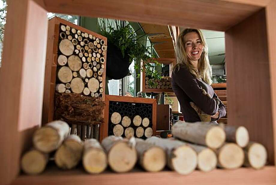 Colleen Smith, a woodsmith by trade,  poses for a photograph with some of the bug houses she makes in her garage on October 21, 2010 in Pacifica, Calif.  Photograph by David Paul Morris/Special to the Chronicle Photo: David Paul Morris, Special To The Chronicle