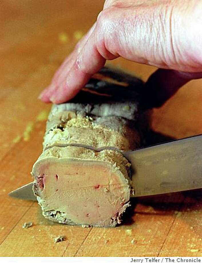Cutting the chilled pate with a sharp hot knife. Photo: Jerry Telfer, The Chronicle