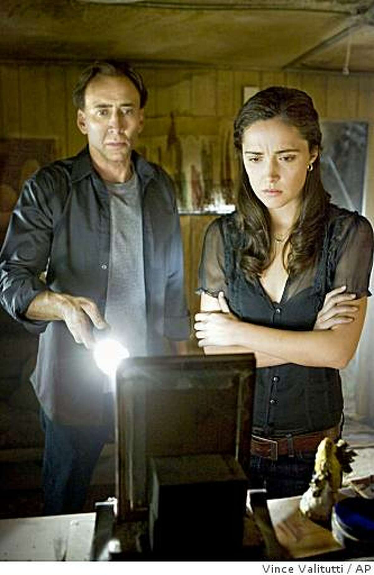 In this film publicity image released by Summit Entertainment, Nicolas Cage, left, and Rose Byrne are shown in a scene from