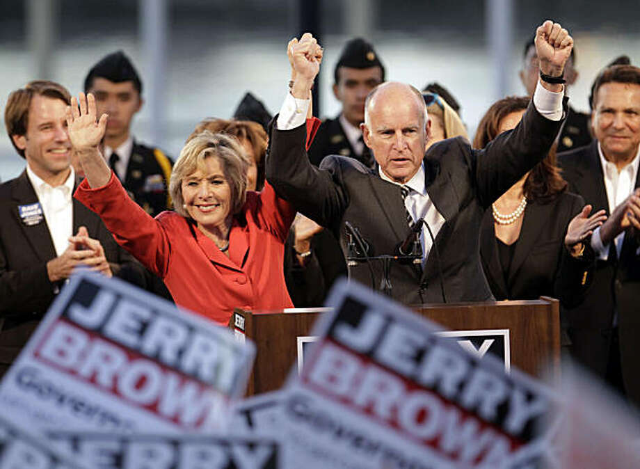 Calif. Attorney General Jerry Brown, right, who is running for Calif. Governor as a Democrat and Sen. Barbara Boxer, (D-Calif.), left, who is running for reelection, raise arms at a rally in Oakland, Calif., Monday, Nov. 1, 2010. Brown is running against former eBay CEO Meg Whitman. Boxer is running against former Hewlett-Packard CEO Carly Fiorina. Photo: Paul Sakuma, AP