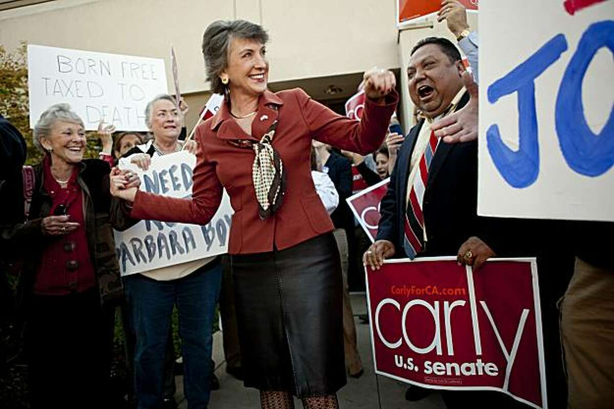 ELK GROVE, CA - NOVEMBER 1: Republican senatorial candidate and former head of Hewlett-Packard Carly Fiorina (C) greets supporters outside a GOP candidate phone bank November 1, 2010 in Elk Grove, California. Political campaigns are making their final push the day before the 2010 midterm elections. Fiorina is in a tight senate race against incumbent U.S. Sen. Barbara Boxer (D-CA).