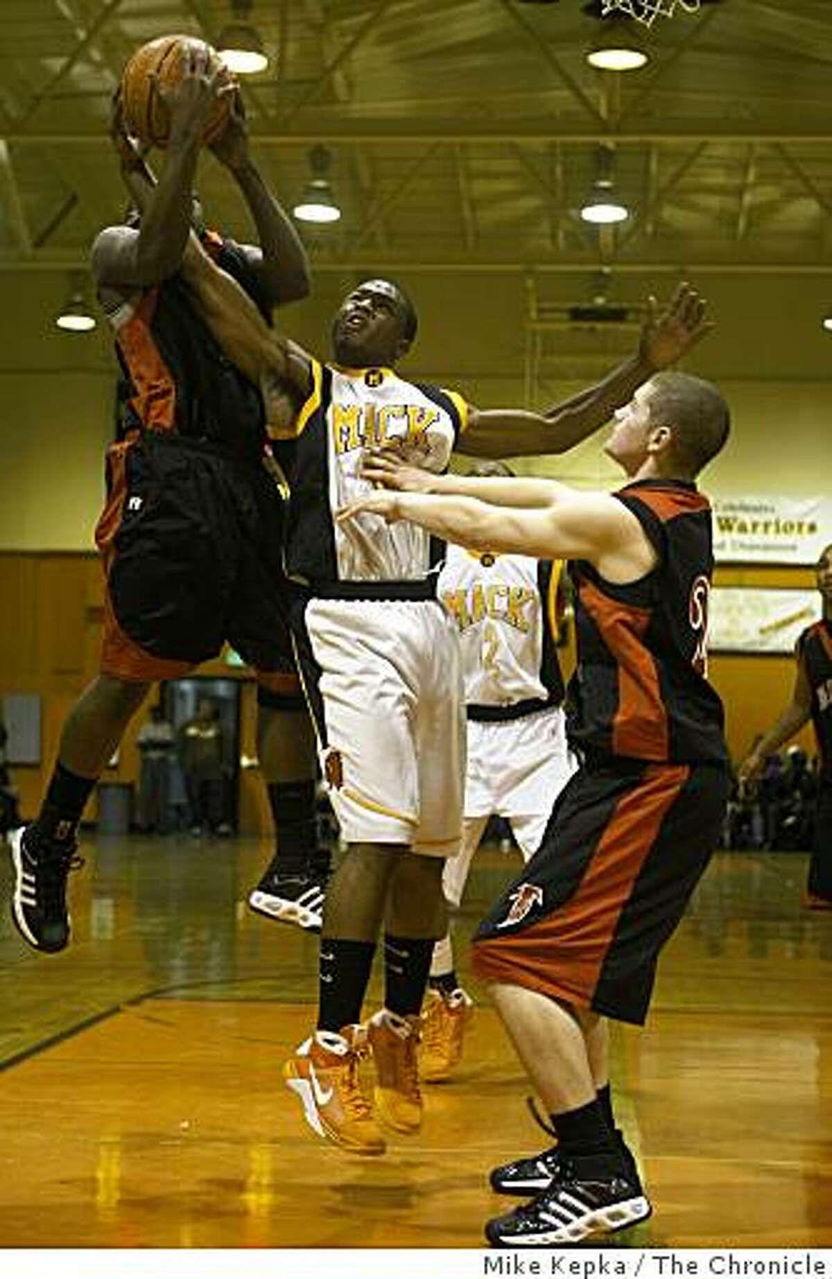 #22 Will Cherry (center) of McClymonds, tries keep control of the ball from #24 Tra' Mayne Bondurant and #23 Josh Lasley (right) of Fairfield at McClymonds High School on Friday Jan. 2, 2009 in Oakland, Calif.