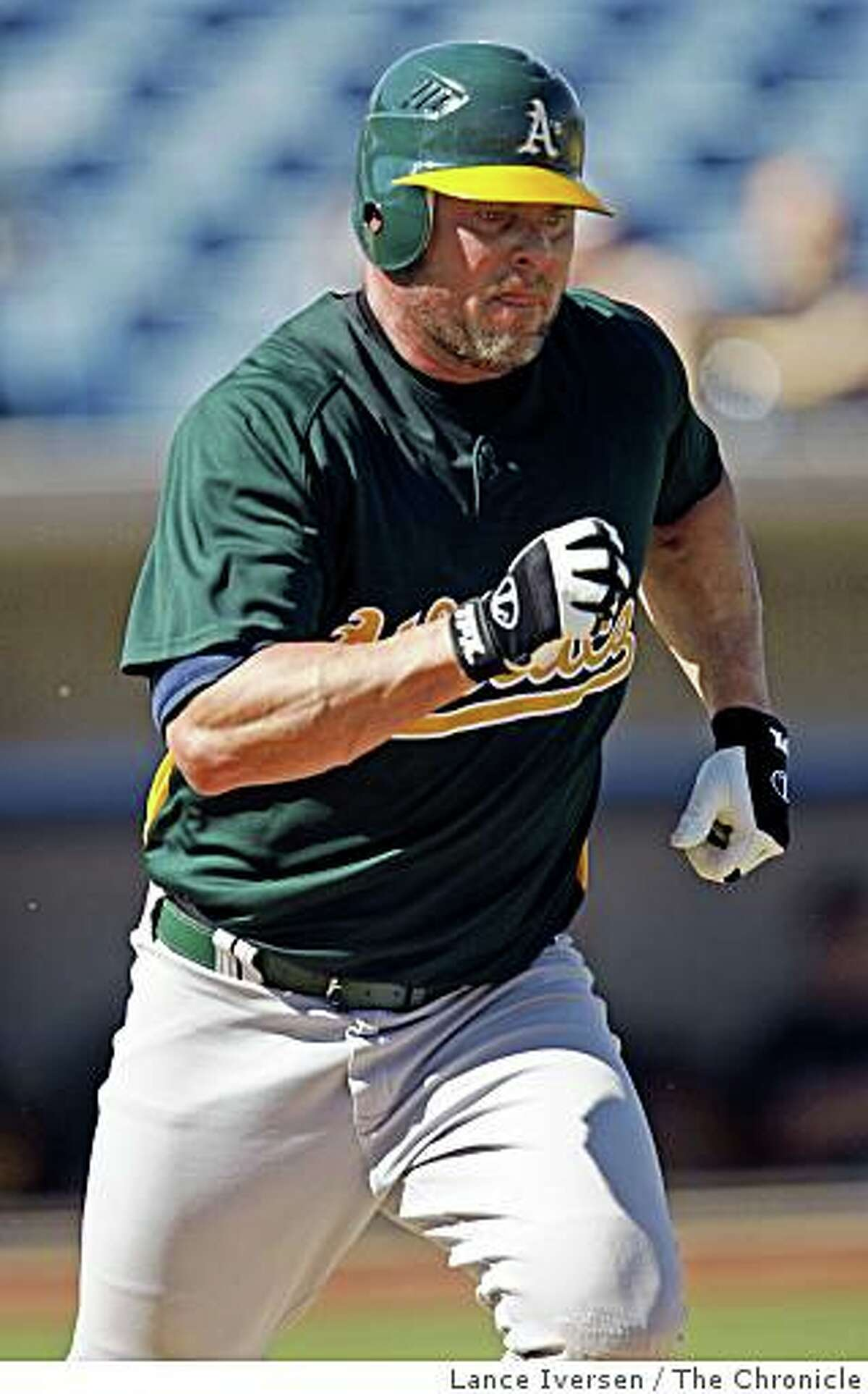 Oakland Athletics Jason Giambi runs down to first base after grownding out during the A's first Spring Training game with the Milwaukee Brewers at Maryvale Baseball Park in Phoenix Arizona Wednesday, February 25, 2009.