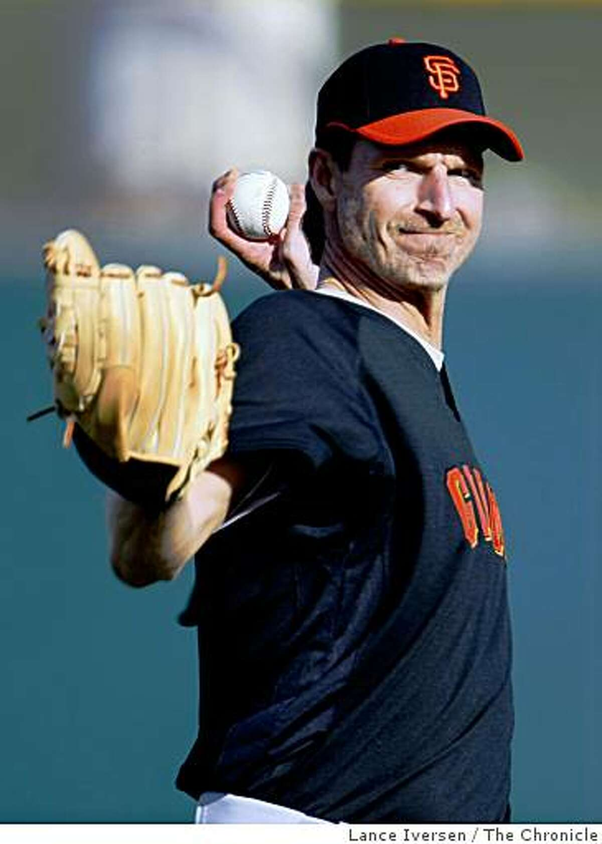 San Francisco Giants pitcher Randy Johnson warms up during the first full day of Spring Training workouts at Scottsdale Stadium Sunday February 15, 2009 in Scottsdale Arizona