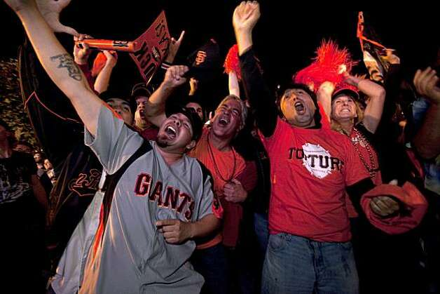 Giants fans react ts as the Giants defeat the Texas Rangers to win the World Series in 5 games at the Civic Center Plaza on November 1, 2010 in San Francisco, Calif.  Photograph by David Paul Morris/Special to the Chronicle Photo: David Paul Morris, Special To The Chronicle