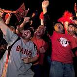 Giants fans react ts as the Giants defeat the Texas Rangers to win the World Series in 5 games at the Civic Center Plaza on November 1, 2010 in San Francisco, Calif.  Photograph by David Paul Morris/Special to the Chronicle