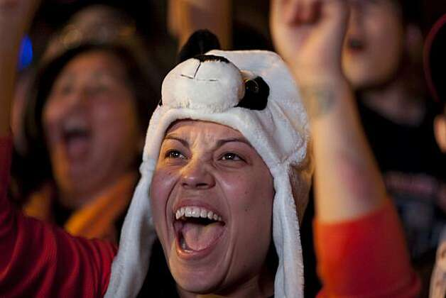 Giants fan Kamilia Elsisie of San Francisco reacts as the Giants defeat the Texas Rangers to win the World Series in 5 games at the Civic Center Plaza on November 1, 2010 in San Francisco, Calif.  Photograph by David Paul Morris/Special to the Chronicle Photo: David Paul Morris, Special To The Chronicle
