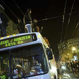 Giants fans celebrate on top of a Muni bus on Market Street after the Giants defeated the Texas Rangers to win the World Series in 5 games on November 1, 2010 in San Francisco, Calif.  Photograph by David Paul Morris/Special to the Chronicle