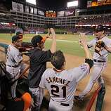 San Francisco Giants first baseman Aubrey Huff is greeted at the dugout after hitting a two-run homer in the third inning of Game 4 of the World Series on Sunday.