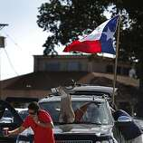 Mark Busch (left) and Jason Shanfield of Dallas prepare to tailgate outside of Rangers Ballpark before they attend Game 4 of the World Series on Sunday.