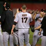 Giants players celebrate their win over the Rangers in Game 4 of the World Series on Sunday.