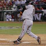 San Francisco Giants shortstop Edgar Renteria hits a single in the seventh inning of Game 4 of the World Series against the Texas Rangers on Sunday.