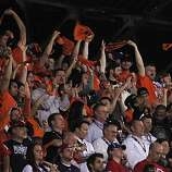 A group of Giants fans cheers during the first inning of Game 4 of the World Series at Rangers Ballpark on Sunday.