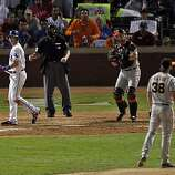 Michael Young of the Rangers looks back at Giants closer Brian Wilson after Wilson struck him out for the second out in the ninth inning of Game 4 of the World Series on Sunday.
