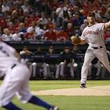 San Francisco Giants starting pitcher Madison Bumgarner throws to first base to force Texas Rangers second baseman Ian Kinsler back to the bag in the second inning of Game 4 of the World Series on Sunday.