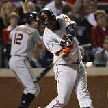 San Francisco Giants shortstop Edgar Renteria gets a fourth inning base hit in Game 4 of the World Series on Sunday.