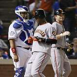 San Francisco Giants shortstop Edgar Renteria scores on a Andres Torres double in the seventh inning of Game 4 of the World Series against the Texas Rangers on Sunday.