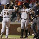 San Francisco Giants center fielder Cody Ross congratulates Buster Posey on his eighth inning homer in Game 4 of the World Series against the Texas Rangers on Sunday.