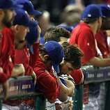 Jeff Francoeur lowers his head as the final Rangers out is called in the ninth inning of Game 4 of the World Series at Rangers Ballpark on Sunday.