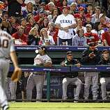 The San Francisco Giants bench applauds starting pitcher Madison Bumgarner, who completed eight innings and shut out the Rangers in Game 4 of the World Series at the Rangers Ballpark on Sunday.