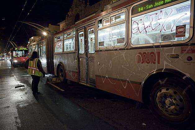 A vandalized MUNI bus on Mission Street after a small riot broke out after the Giants defeated the Texas Rangers to win the World Series in 5 games on November 1, 2010 in San Francisco, Calif.  Photograph by David Paul Morris/Special to the Chronicle Photo: David Paul Morris, Special To The Chronicle