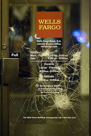 Vandalism is shown on a door to Wells Fargo Bank on Mission Street after a small riot broke out after the Giants defeated the Texas Rangers to win the World Series in 5 games on November 1, 2010 in San Francisco, Calif.  Photograph by David Paul Morris/Special to the Chronicle Photo: David Paul Morris, Special To The Chronicle