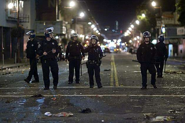 San Francisco Police walk down Mission Street after a small riot broke out after the Giants defeated the Texas Rangers to win the World Series in 5 games on November 1, 2010 in San Francisco, Calif.  Photograph by David Paul Morris/Special to the Chronicle Photo: David Paul Morris, Special To The Chronicle
