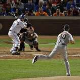 Giants pitcher Madison Bumgarner strikes out Mitch Moreland looking in the bottom of the eighth inning to close out the frame. Bumgarner shut out the Rangers for eight innings and allowed only three hits in Game 4 of the World Series on Sunday.