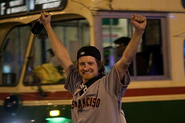 A Giants fan celebrate on Market Street after the Giants defeated the Texas Rangers to win the World Series in 5 games on November 1, 2010 in San Francisco, Calif.  Photograph by David Paul Morris/Special to the Chronicle Photo: David Paul Morris, Special To The Chronicle