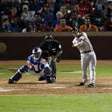 Buster Posey hits a solo home run off Rangers reliever Darren O'Day in the eighth inning of Game 4 of the World Series on Sunday.
