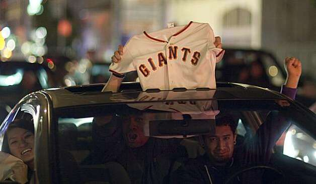 Giants fans celebrate on Mission Street after the Giants defeated the Texas Rangers to win the World Series in 5 games on November 1, 2010 in San Francisco, Calif.  Photograph by David Paul Morris/Special to the Chronicle Photo: David Paul Morris, Special To The Chronicle
