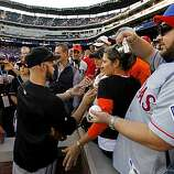 Cody Ross stops to sign autographs for fans in the stands as the Giants warm up before Game 4 of the World Series against the Texas Rangers on Sunday.