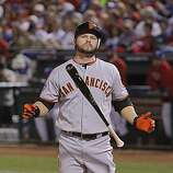 San Francisco Giants center fielder Cody Ross (13) shows some frustration after swinging for strike two in the sixth inning of Game 4 of the World Series against the Texas Rangers on Sunday.