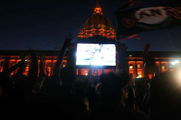 Giants fans celebrate Edgar Renteria's home run while watching game 5 of the World Series in Civic Center plaza  in San Francisco, Calif., on Monday, November 1, 2010. Photo: Douglas Zimmerman, Courtesy To The SF Gate