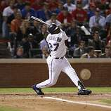 Texas Rangers designated hitter Vladimir Guerrero swings and misses in the second inning of Game 4 of the World Series on Sunday.