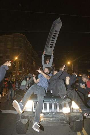 Giants fans celebrate the World Series win on top of a vehicle at the intersection of 4th Street and Townsend Street in San Francisco, Calif., on Monday, November 1, 2010. Photo: Douglas Zimmerman, Courtesy To The SF Gate